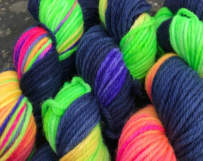 "50g 100% Superwash Merino DK double knit yarn, hand dyed in Scotland, navy rainbow variegated ""fireworks"""