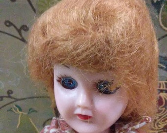 Vintage Madam Alexander doll. red hair and blue eyes. Spotted shirt and khauki shorts.