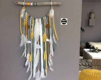 Dream catcher in white, mustard and blue/green Driftwood with clouds