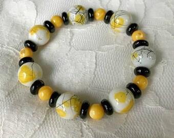 Iowa Hawkeye's beaded stretch bracelet, Black and gold jewelry, Hawkeye jewelry