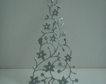 Cutout tree snow covered with silver vinyl for design drawing paper