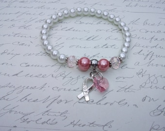 White and pink pearl bracelet with hope ribbon and crystal heart
