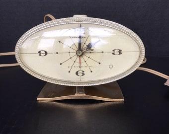 Cute oval General Electric vintage bedside or desk clock
