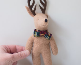Small stuffed deer with a red bowtie