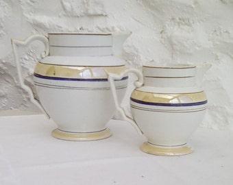 Pair of French antique lustre jugs, Creil et Montereau, early 20th century.