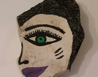 Face on a stone