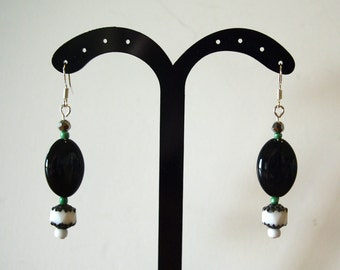 Black, white and green dangly earrings. Ceramic and glass.