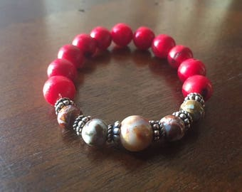 Sophisticated, red coral gemstone bead bracelet with natural tourmaline accent beads surrounded by sterling silver spacer beads.
