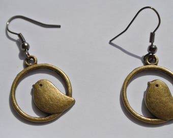 a pair of birds on circles earrings