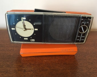 Radio alarm clock featuring orange 1970's