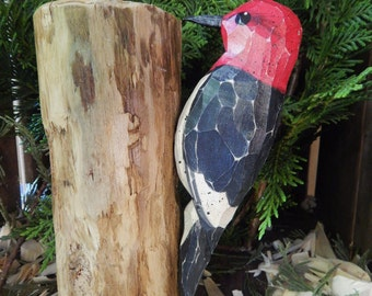 Carved Red Headed Woodpecker on Pine Tree