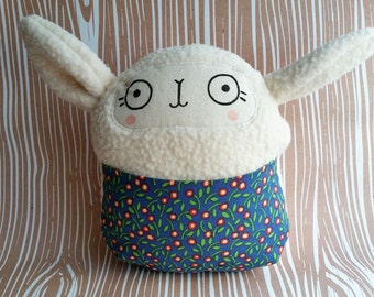 Stuffed sheep soft baby toy with bright floral front pouch. Handmade.