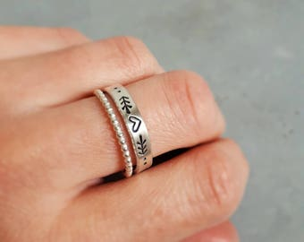 Wide silver ring engraved with a heart and arrow heart ring