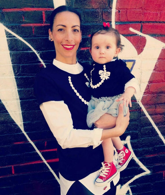 Mommy and Me Matching Necklace with Pearls and Bow T-shirt for Women and Baby Bodysuit Pictured in Black with White Necklace