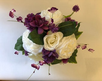 Purple and White artificial flower arrangement in a purple vase