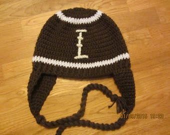 Crocheted football hat with ear flaps.