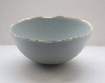 Blue porcelain bowl. Stoneware porcelain bowl in duck egg blue with gold rims.