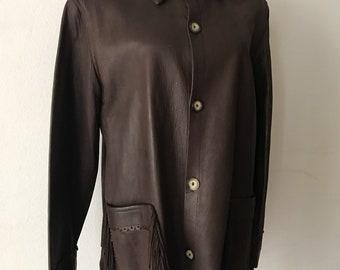Brown vintage fringe leather jacket women's size medium .
