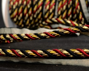 "3/8"" 401 274 Black Gold Red Lip Cord Trim"