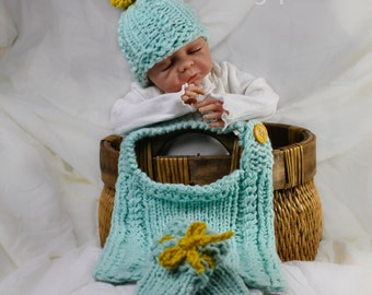 Loom Knit Cable baby Bib, Newborn Hat and Baby Mitts PATTERN. Loom Knitting PATTERN. Includes Newborn Hat, Bib (one size) and mitts.