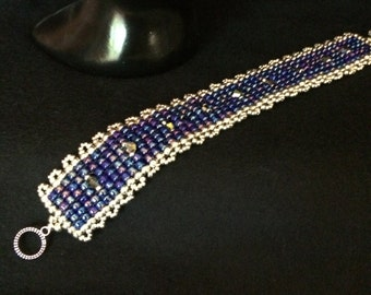 NO 54 Hand woven crystal and glass bracelet