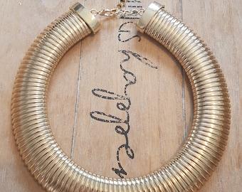 Stunning gold tone statement collar necklace