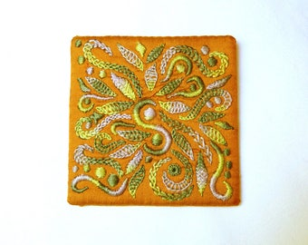 Brooch embroidered on silk