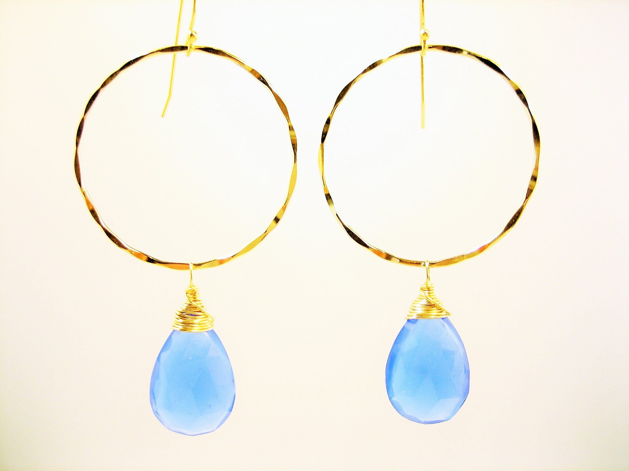 Boho - Gypsy hammered golden circle earrings with bright blue chalcedony, blue and gold artisan earrings, handmade hammered gold earrings