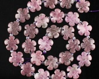 Fabulous strand of 27 mod flower power shaped Lepidolite beads.