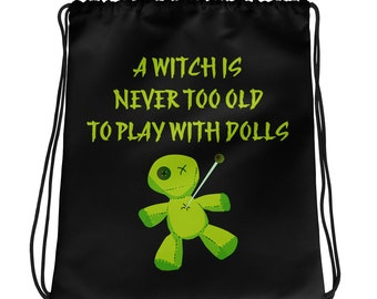 A Witch is Never Too Old To Play With Dolls Cheeky Witch® Drawstring bag