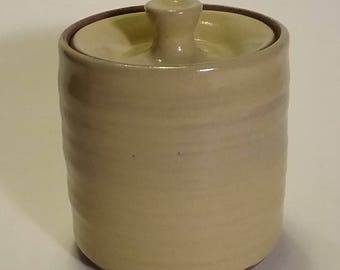 Handmade wheel thrown pottery lidded jar, sugar bowl, yellow