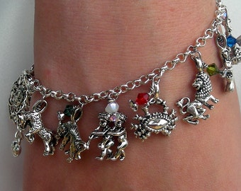 Zodiac Charm Bracelet all 12 symbols of astrological signs are on this bracelet with a Sun Zodiac Charm to top it off at lucky13 aries taurus gemini cancer leo virgo libra scorpio saggitarius capricorn aquarius pisces