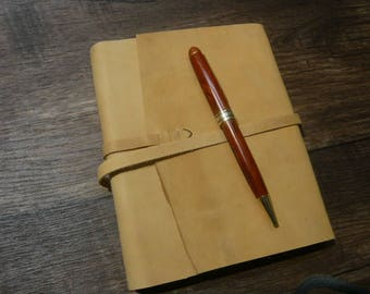 Vintage Reclaimed wraparound diary in golden cowhide, cut edge style.