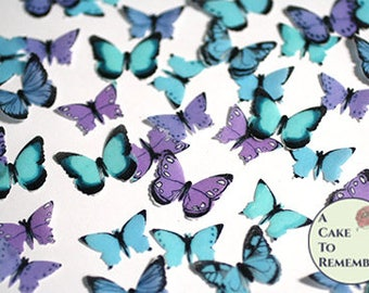 """48 small teal, blue and purple edible butterflies, 1/2- 3/4"""" across. More colors available. Wafer paper butterflies for cake pops, cupcakes."""