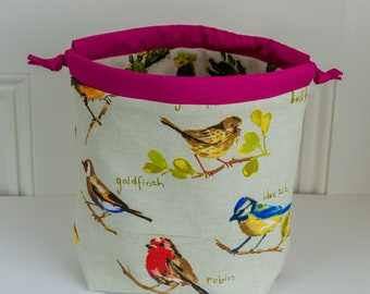 Reversible drawstring project bag made with heavyweight cotton prints featuring flowering cacti on one side and UK garden birds on the other