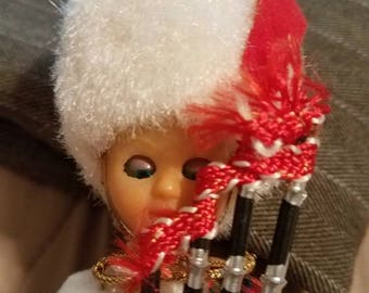 Vintage blinking Scottish doll