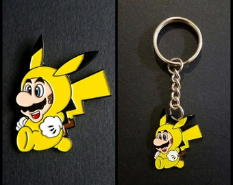 Mario and Pikachu crossover! MarioChu get either the Keychain or the enamel Pin! Or both!