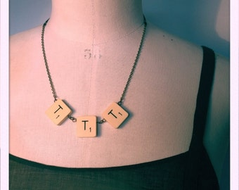 """""""TTT"""" necklace with vintage scrabble letters. Chain and black sheer ribbon."""