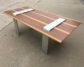 Custom one-off coffee table. Solid aluminum legs with reversible Mahogany/ Mozambique top