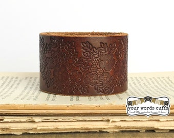 your words cuffs - custom hand stamped leather belt bracelet - personalized with your words - brown floral embossed - leather cuff