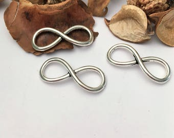 4 infinity, curved, 8 or bow tie-shaped silver connectors