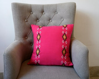 Pink cushion with white and green diamond pattern