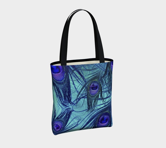 peacock feathers pattern blue and purple tote bag