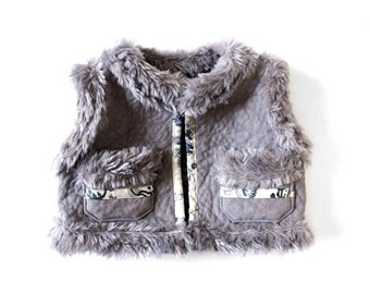 Suede and fur sleeveless jacket
