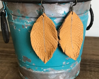 Leather feather earrings in Mustard leather