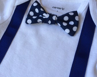 Baby boy polka dot navy bow tie with navy suspenders onesie. Newborn take home, baby shower gift, new mom gift