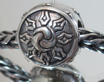 The wheel of Life silver charm