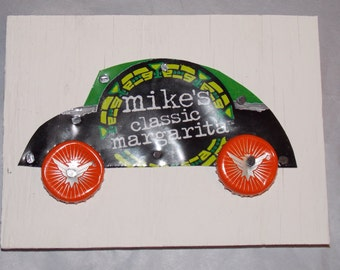 Soda Pop Art, Recycled UpCycled Soda Can VW Beetle Car Shaped Mikes Hard Margarita Seagrams Bottle Caps on Painted Plywood board