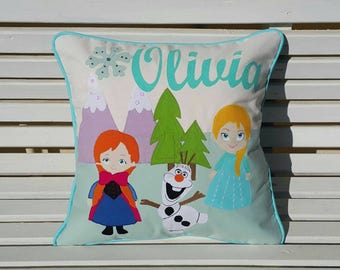 Personalised appliquéd character cushion covers.