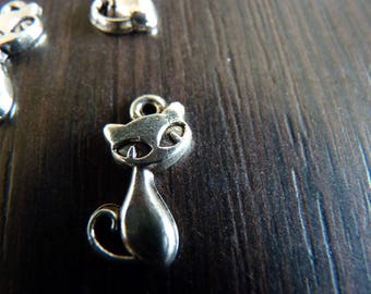 2 silver stylized metal cat charms